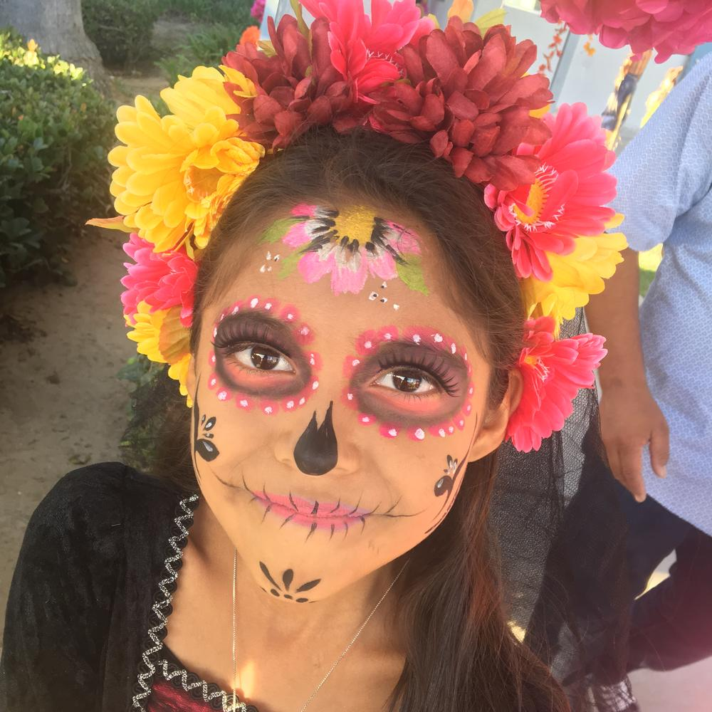 Child with dia de los muertas make-up
