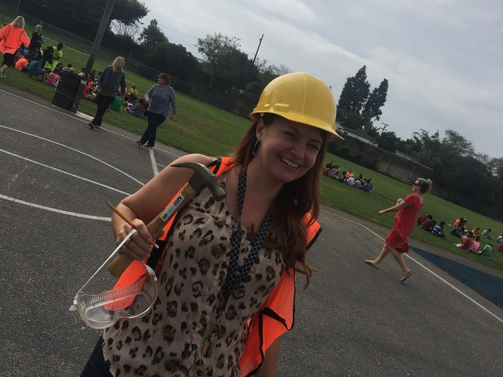 Melissa Gramata with safety hat, hammer, and goggles