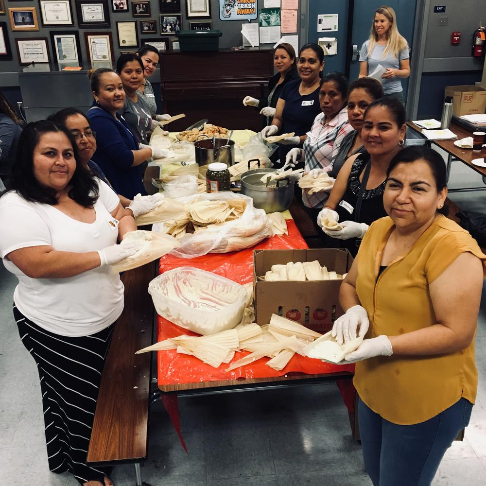 Volunteers making tamales