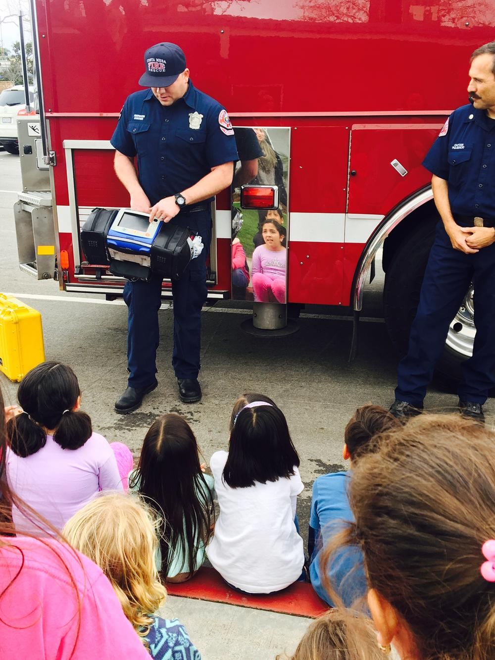 Firefighter Displays Equipment for students